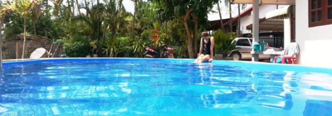 cropped-coconut-palms-swimming-pool-and-bungalows-maha-sarakham-crop1.jpg