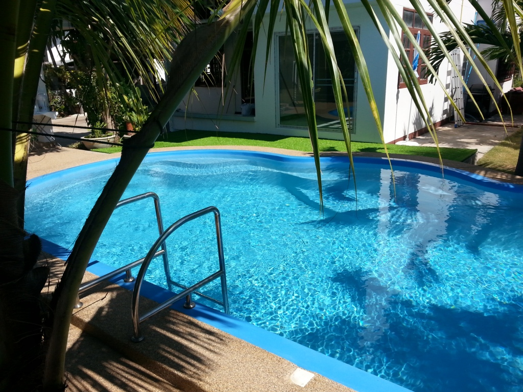 Coconut palms swimming pool in Maha sarakham